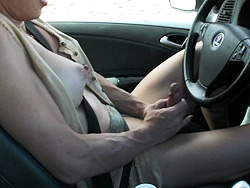 Roadtrip 2 TMILF playing with her fat cock while driving a car.