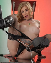 Boots and stockings Lustful TMILF Jasmine Jewels showing it all.