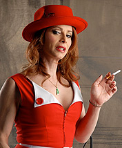Vintage red dress. Jasmine smoking & posing in a lusty vintage dress