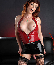 Jasmine latex miniskirt. Petite Jasmine posing in a excited latex miniskirt