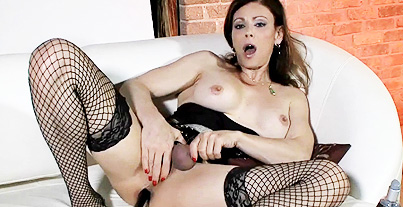 Glass dildo. Libidinous Jasmine drilling her backside with a glass dildo